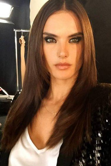 Alessandra Ambrosio backstage with brunette long straight hair wearing a white t-shirt