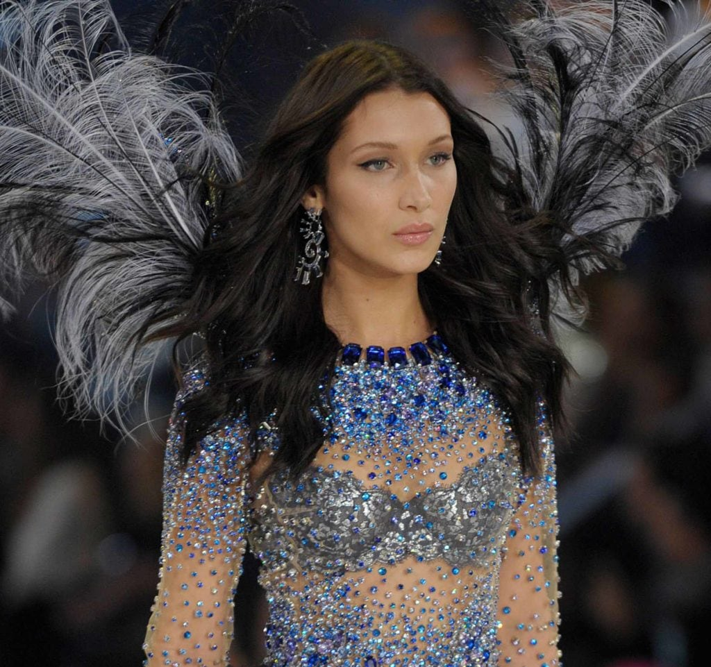 Bella Hadid on the runway of the Victoria's Secret show with long dark wavy hair