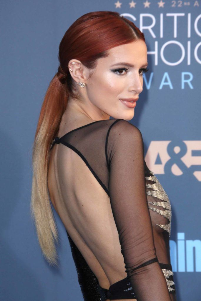 Bella Thorne with her long hair in an ombre ponytail