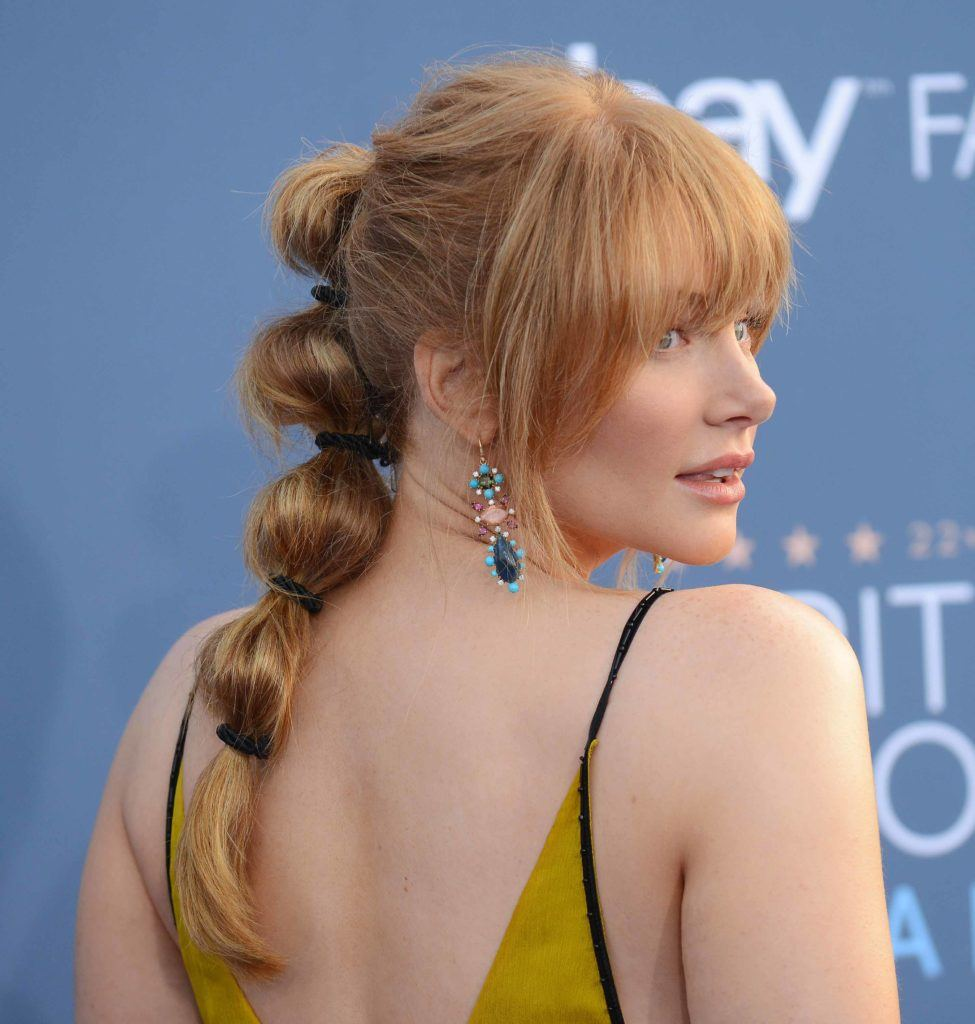 Bryce Dallas Howard on the red carpet with her strawberry blonde hair styled into a bobby ponytail