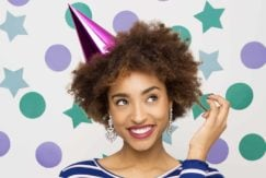 curly hair: All Things Hair - IMAGE - afro hair out with festive hat
