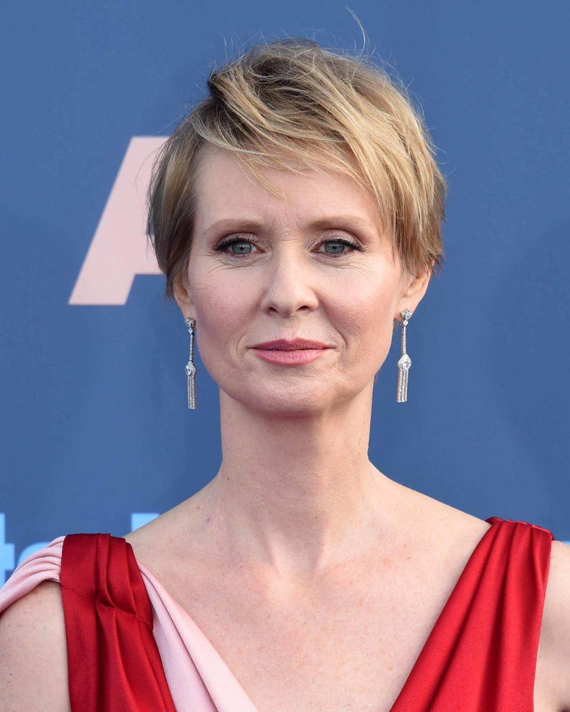Cynthia Nixon on the red carpet with a highlighted pixie crop