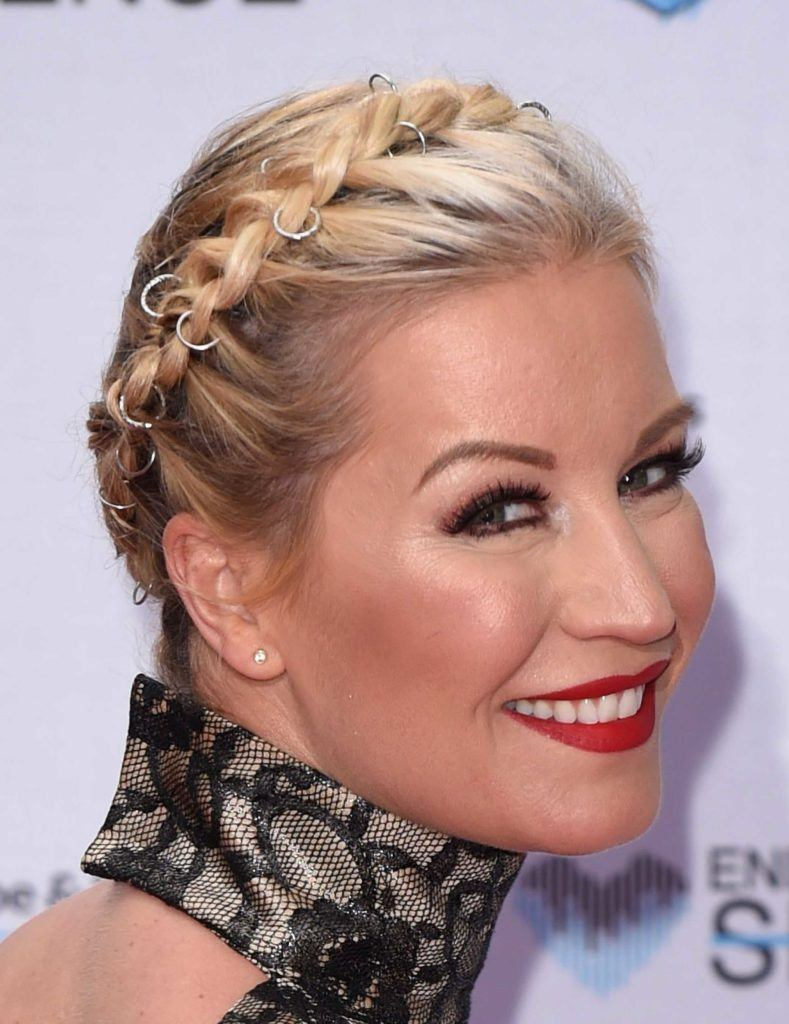 Denise Van Outen with a blonde braided updo and hair rings