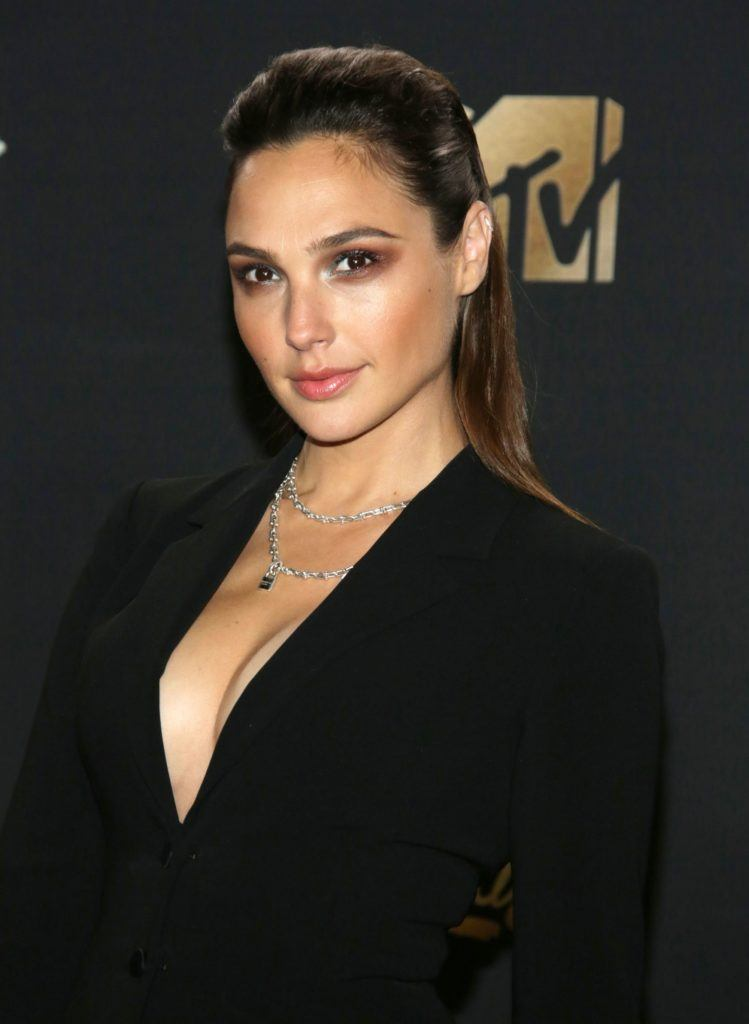 Gal Gadot swept back long brown hair with small quiff finish