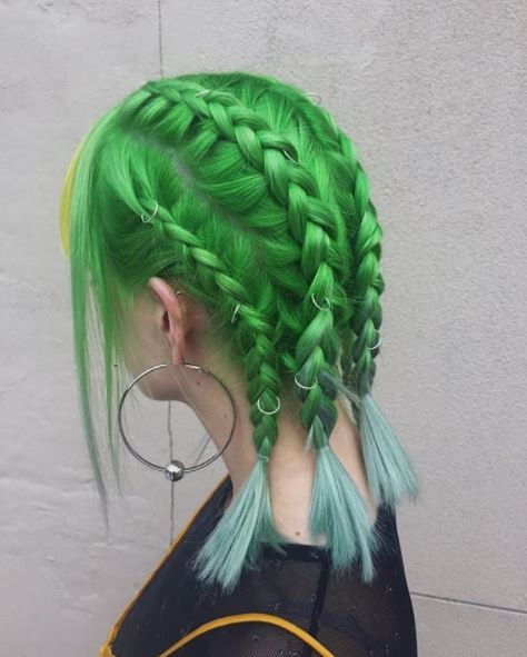 side view of green braided hair with hair rings