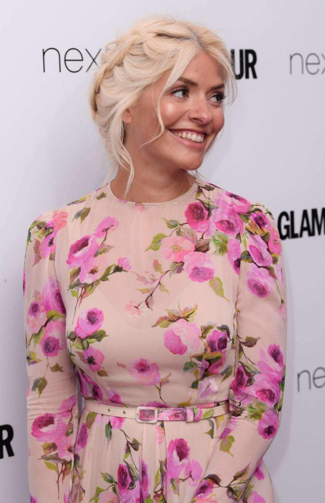 Holly Willoughby with light blonde styled into a milkmaid braid