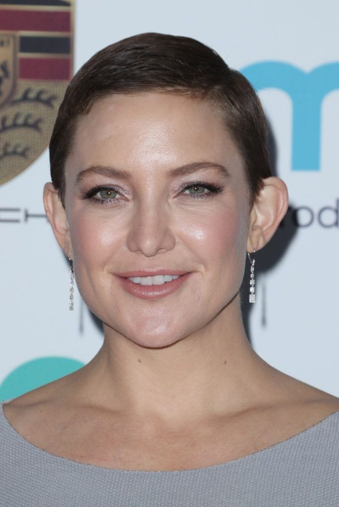 close up shot of kate hudson with short sleek crop hairstyle on the red carpet