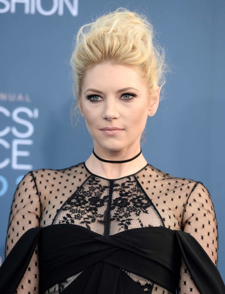 Katheryn Winnick on the red carpet with her blonde hair styled into a bouffant updo