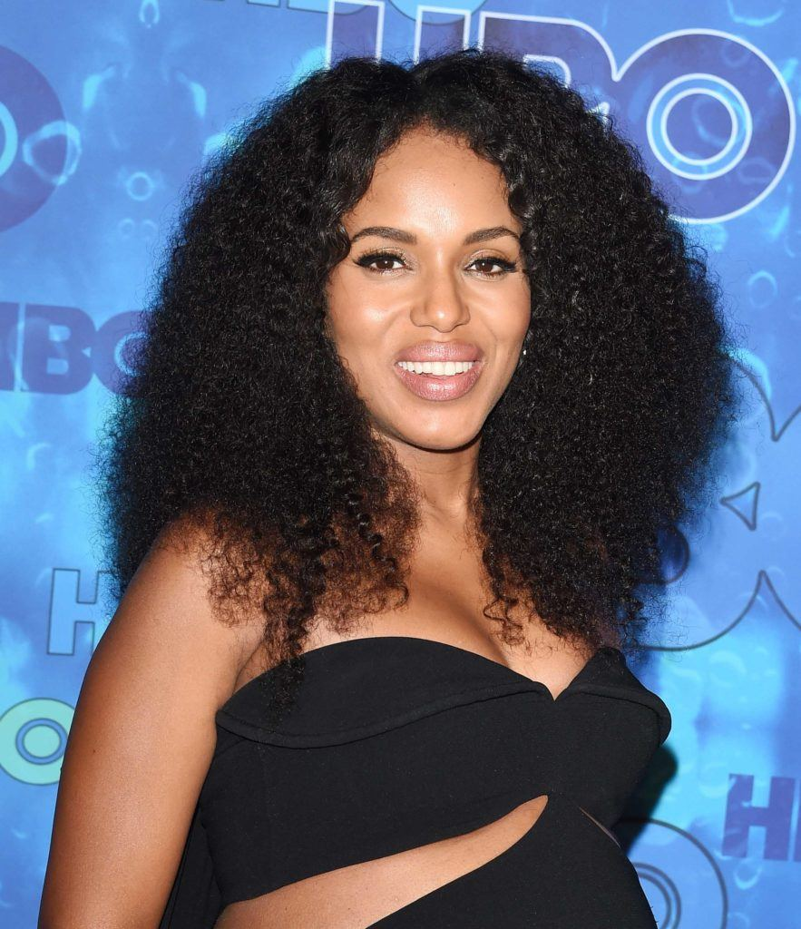 close up shot of kerry washington with big curly afro, wearing black dress on the red carpet