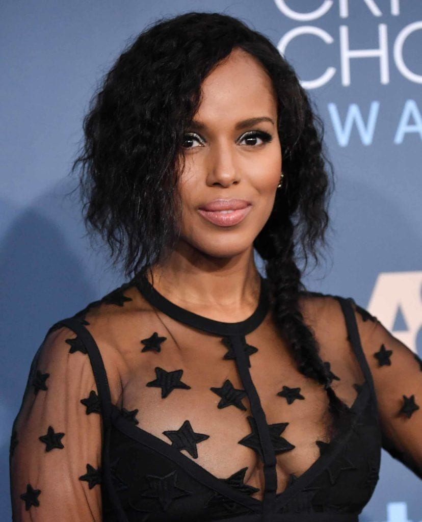 Kerry Washington on the red carpet with her dark brown hair worn half braided with her afro hair sticking out