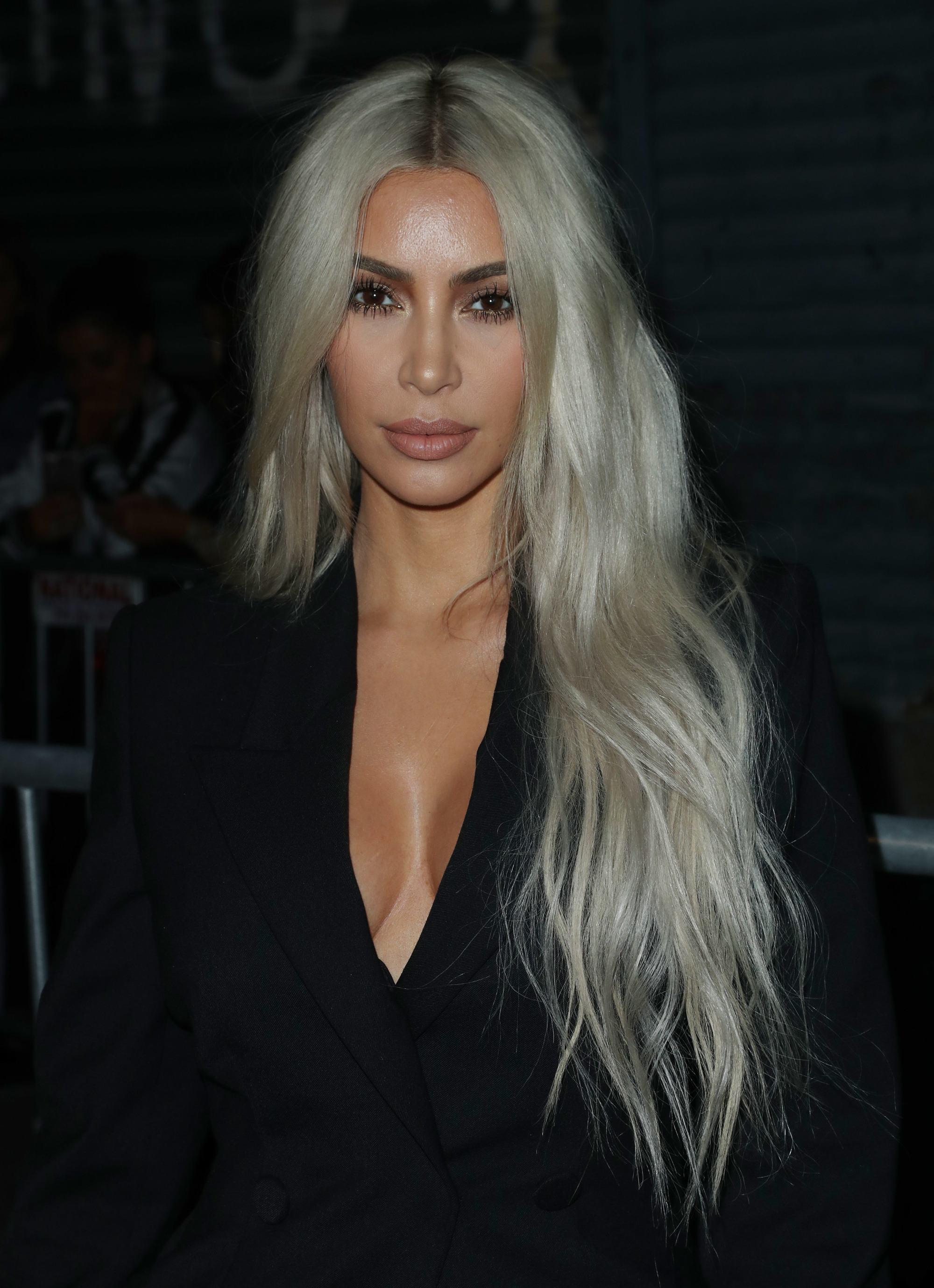 close up shot of kim kardashian west with long silver wavy hair, wearing black jacket at new york fashion week