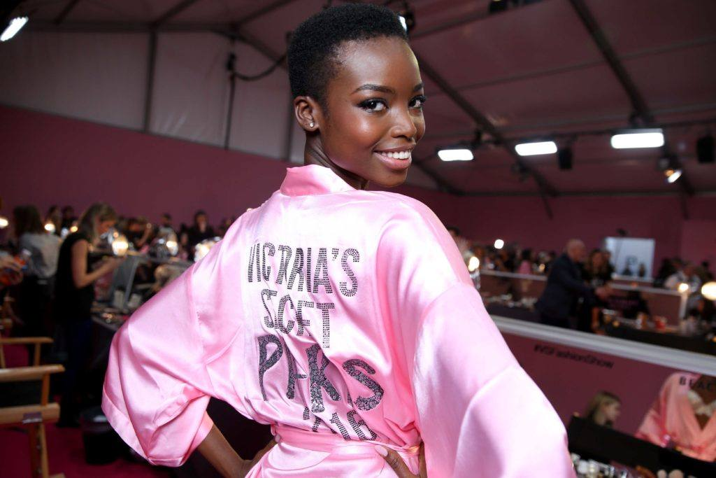 close up shot of Maria Borges with teenie weenie afro hairstyle, wearing pink victoria secret robe at the victora secret show