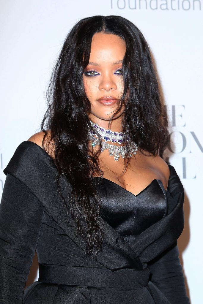 Close up shot of Rihanna with black hair styled into loose beach waves