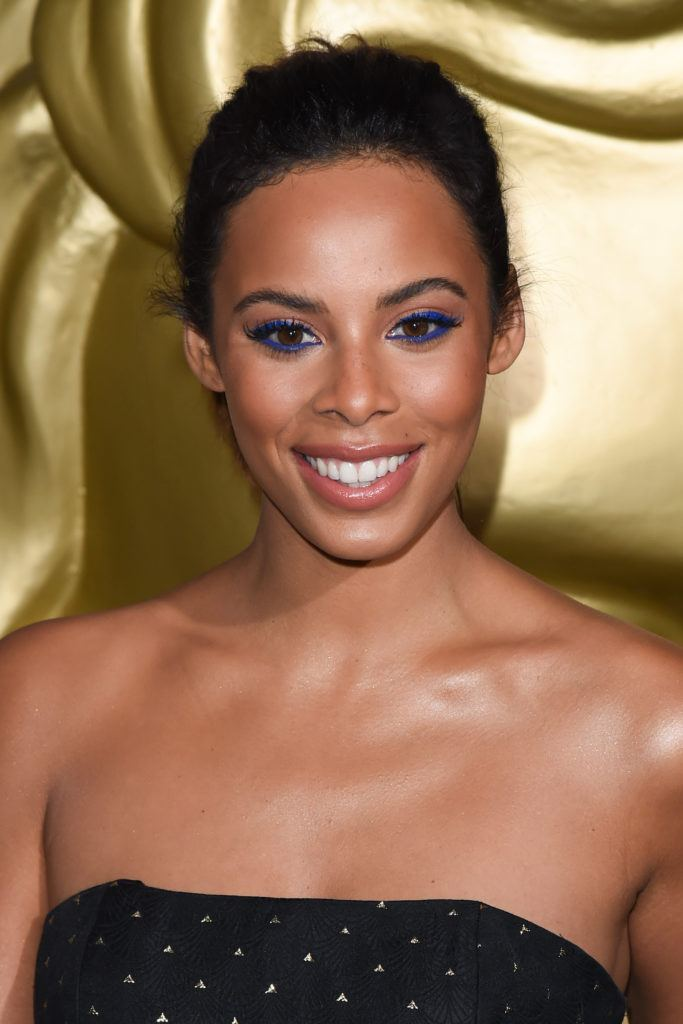 close up shot of rochelle humes with slicked back hair, wearing golden makeup on BCAC awards red carpet