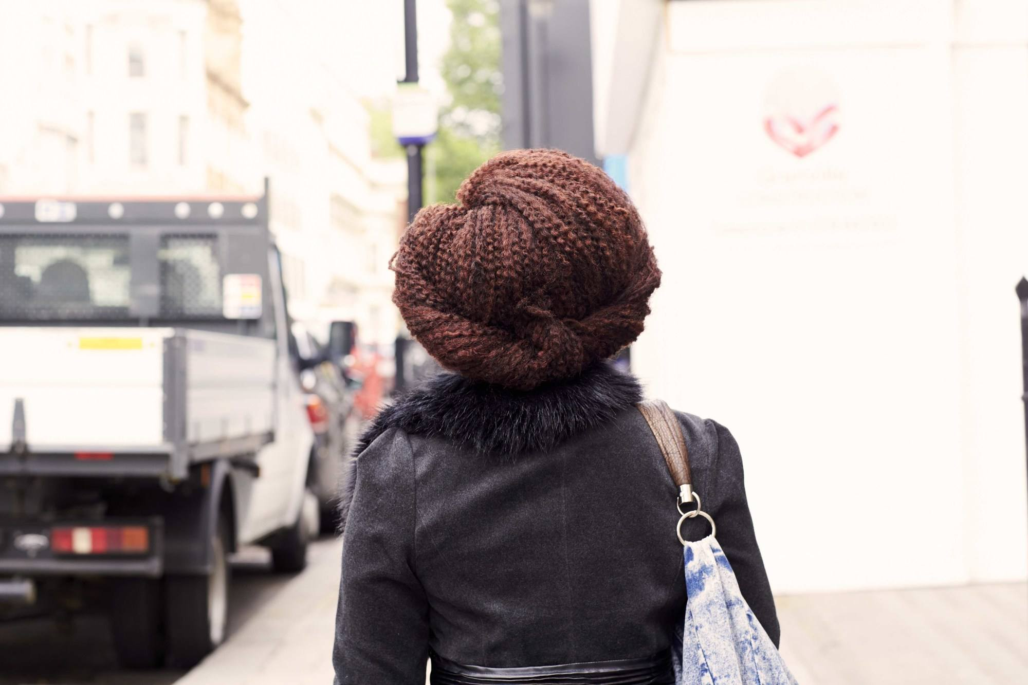 back view of a woman with retro inspired, twisted up-do - winter hairstyles