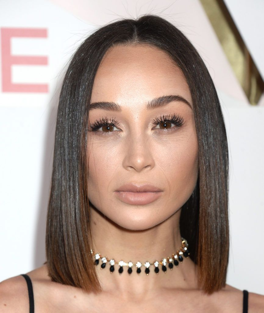 Cara Santana with sleek dark hair in a long bob