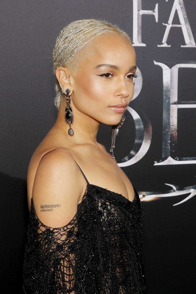 close up shot of zoe kravitz with blonde micro plaits on the red carpet