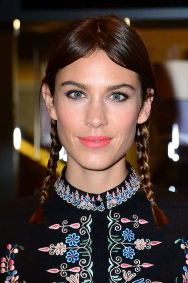Closeup of Alexa Chung with braided pigtail plaits
