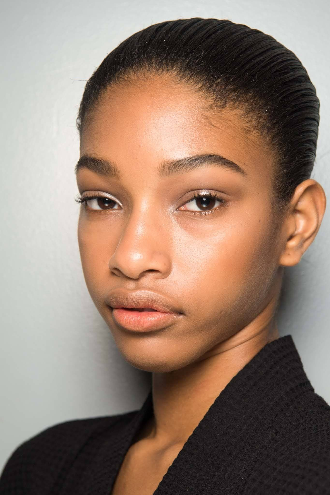 Short black hair: A black model with wet-look short hair from the Alexander Wang AW18