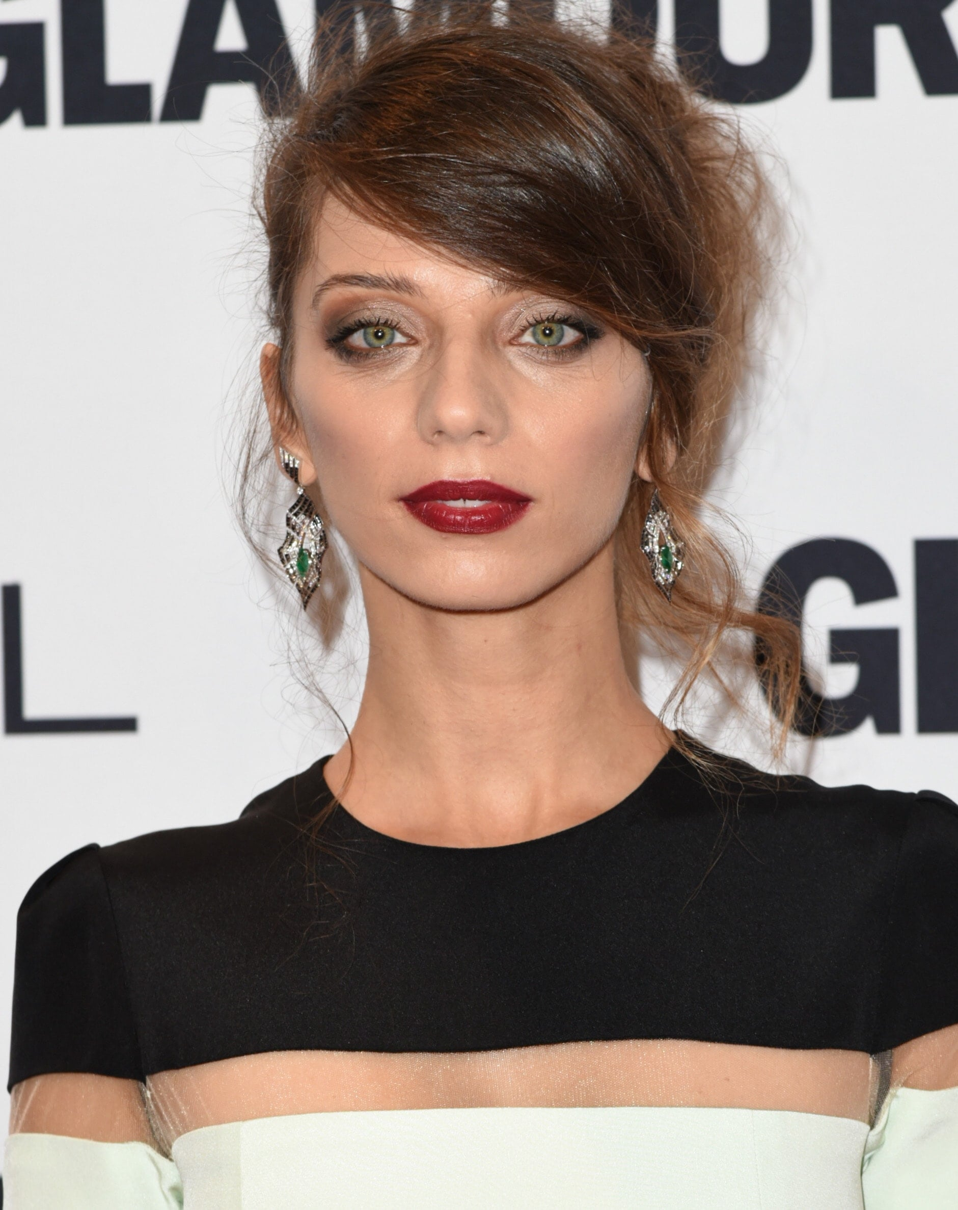 Westworld's Angela Sarafyan with long side bangs hairstyle