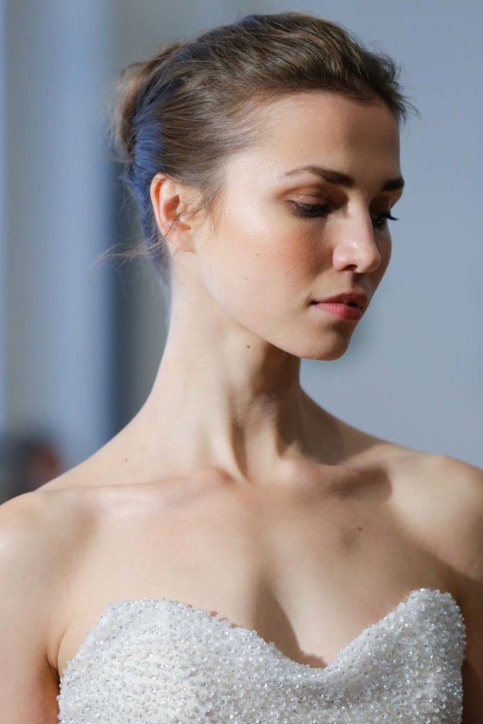 updos for a wedding: A brunette with a ballerina-inspired bun hairstyle Carol Hannah FW 17