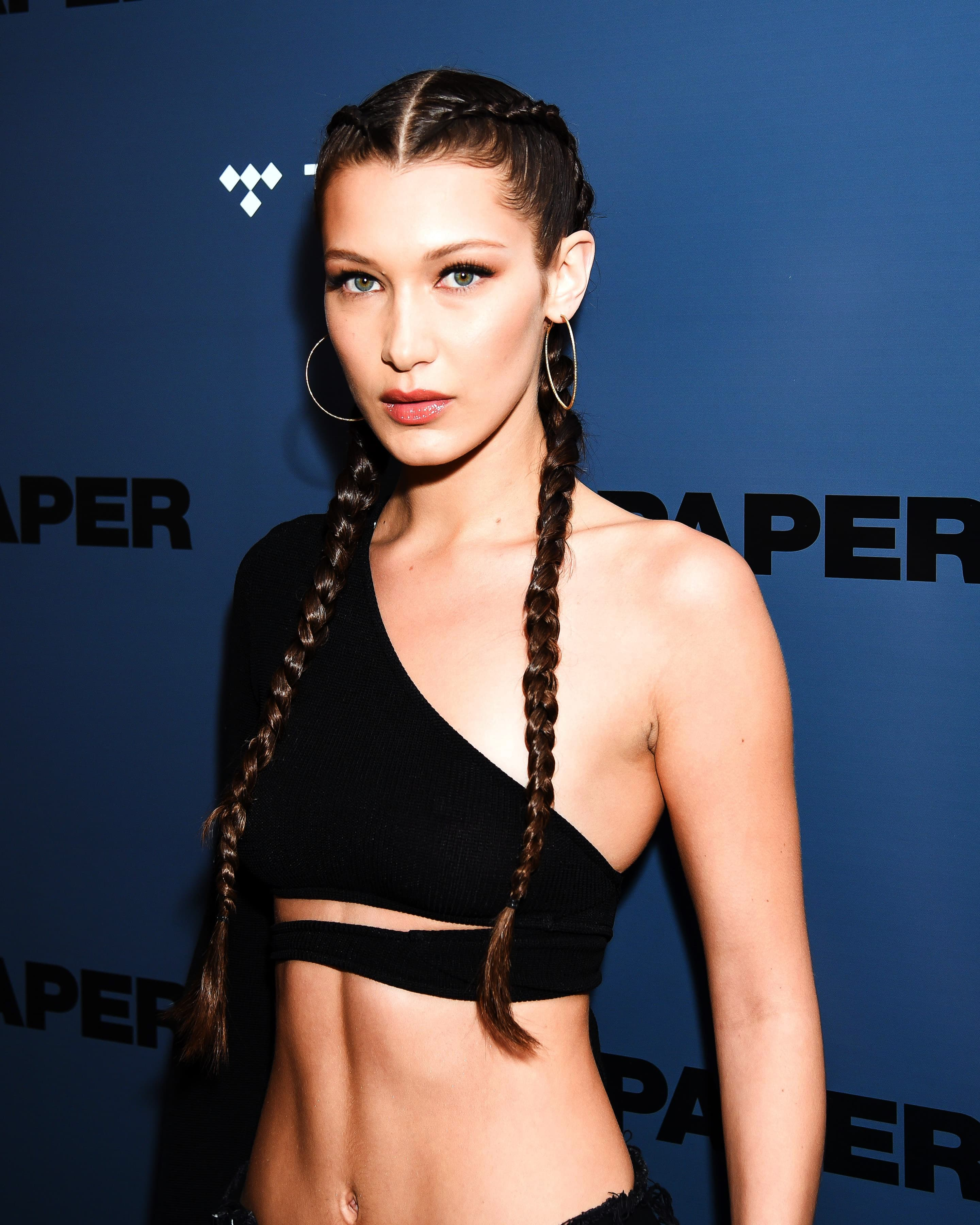workout hairstyles: All Things Hair - IMAGE - Bella Hadid gym hairstyle