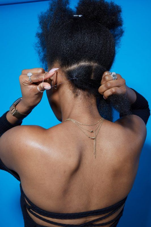 How to do box braids tutorial woman with afro hair parting it and tying with hairband