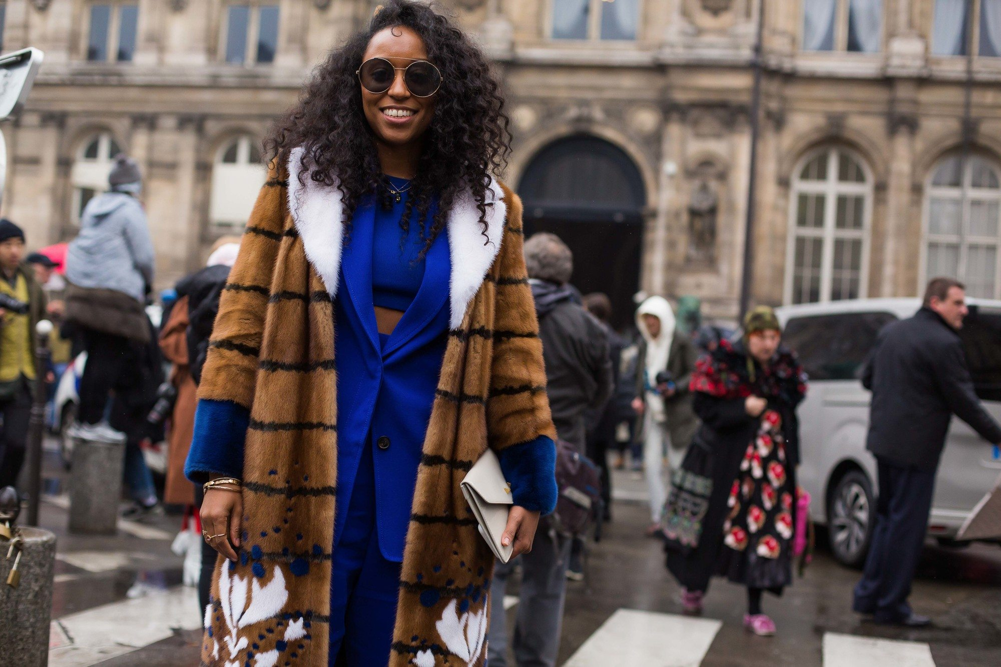 black haired street style model at fashion week with curly braid out hair