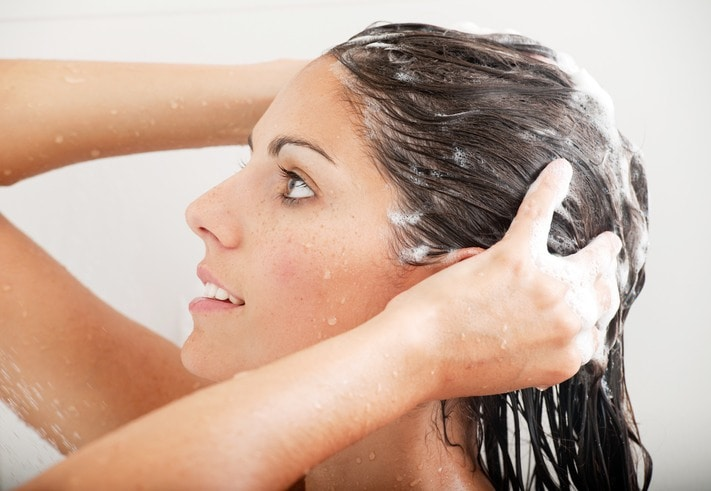Brunette woman washing her hair