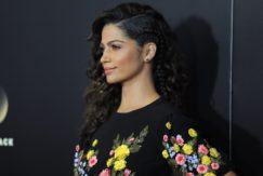 Camila Alves with a side braided curly hairstyle wearing a floral dress