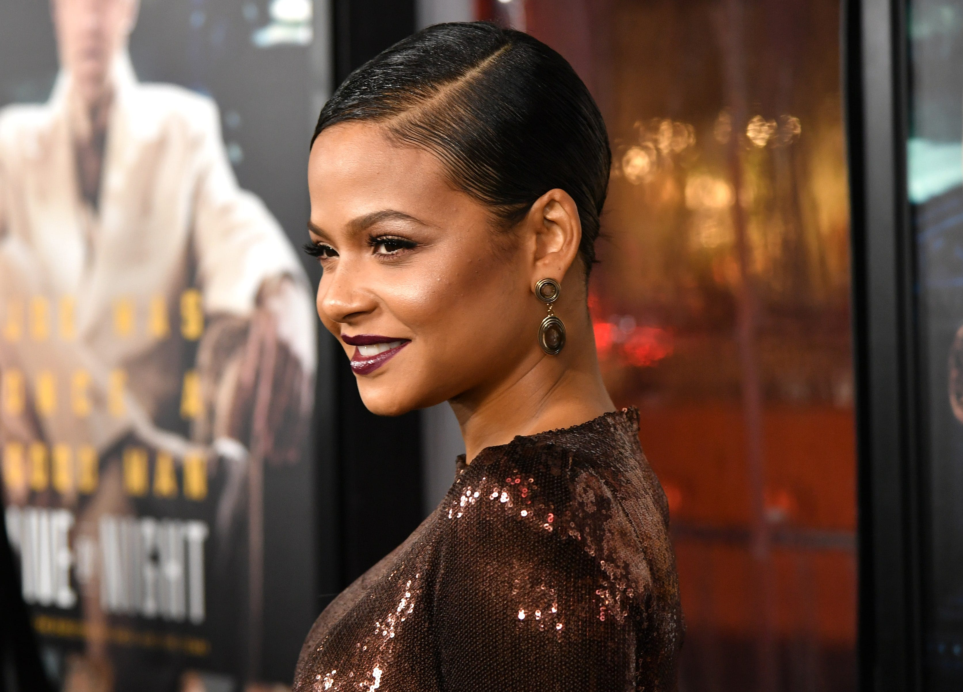 Christina Milian wearing a sleek short hairstyle with side parting
