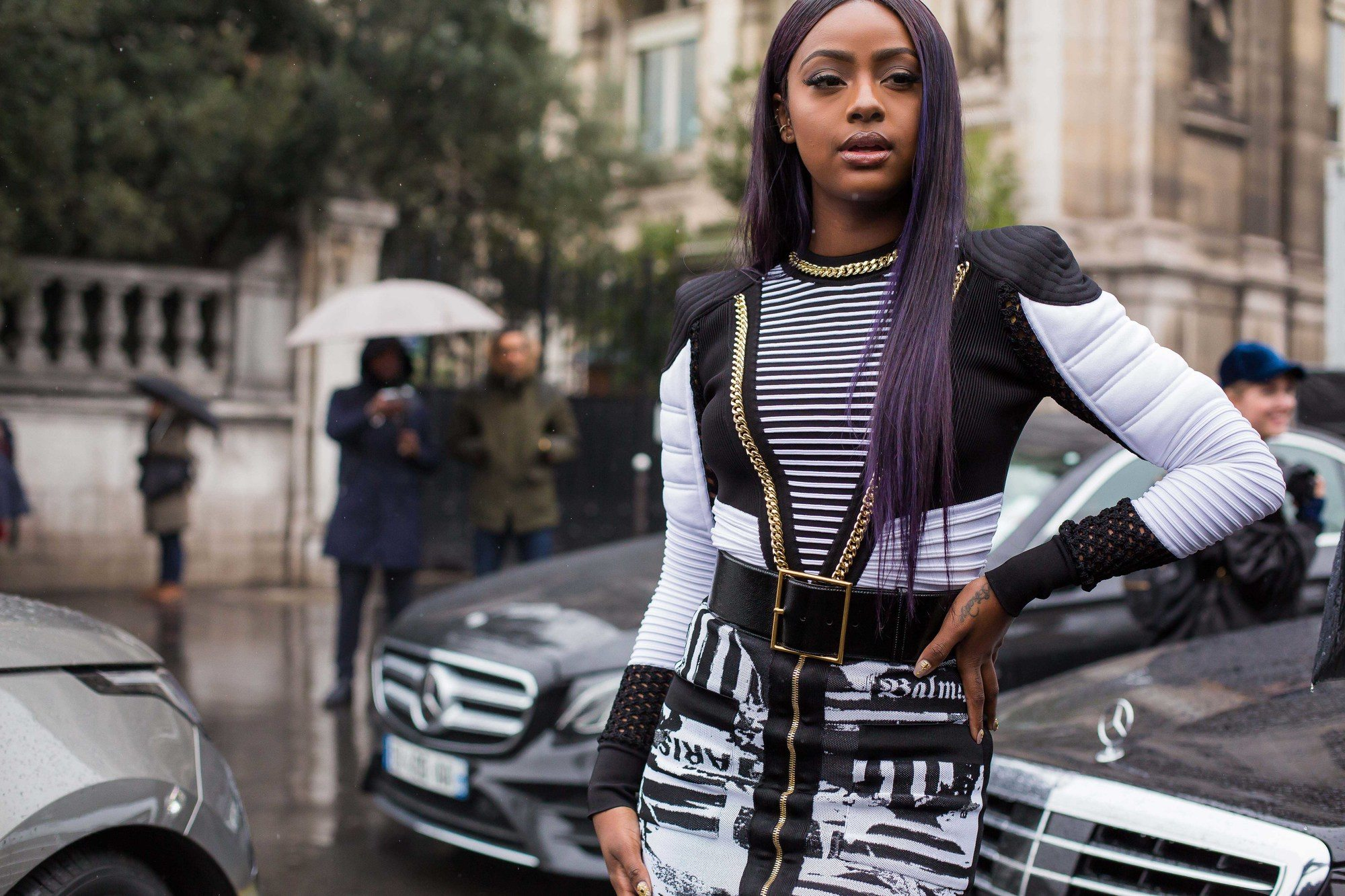 street styler standing in the road with a long purple straight hair wig