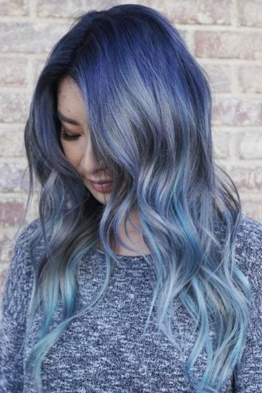 An Instagrammer with wavy denim blue ombre hair