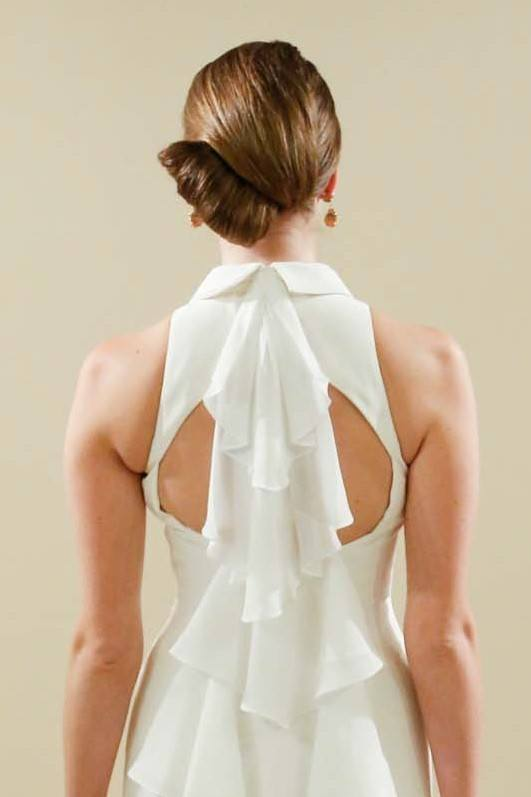 Wedding updos: back view of a brunette model at Matthew Christopher Bridal show FW17 with a modern French Twist hairstyle