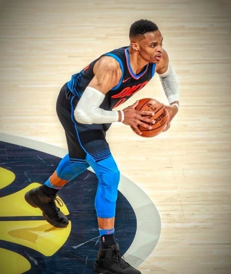 side view of Russell Westbrook playing basketball with black hair and short back and sides