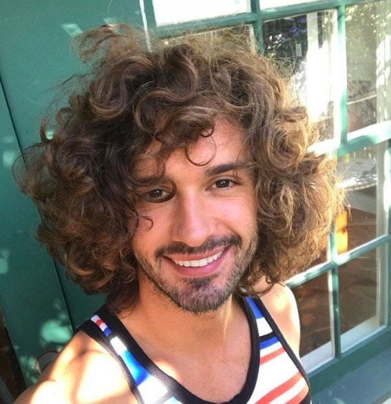 front view image of The Body Coach with long curly hair