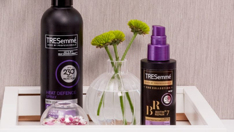Best heat protection spray: Lifestyle image of TRESemme Biotin Repair 7 and Heat Defence Spray