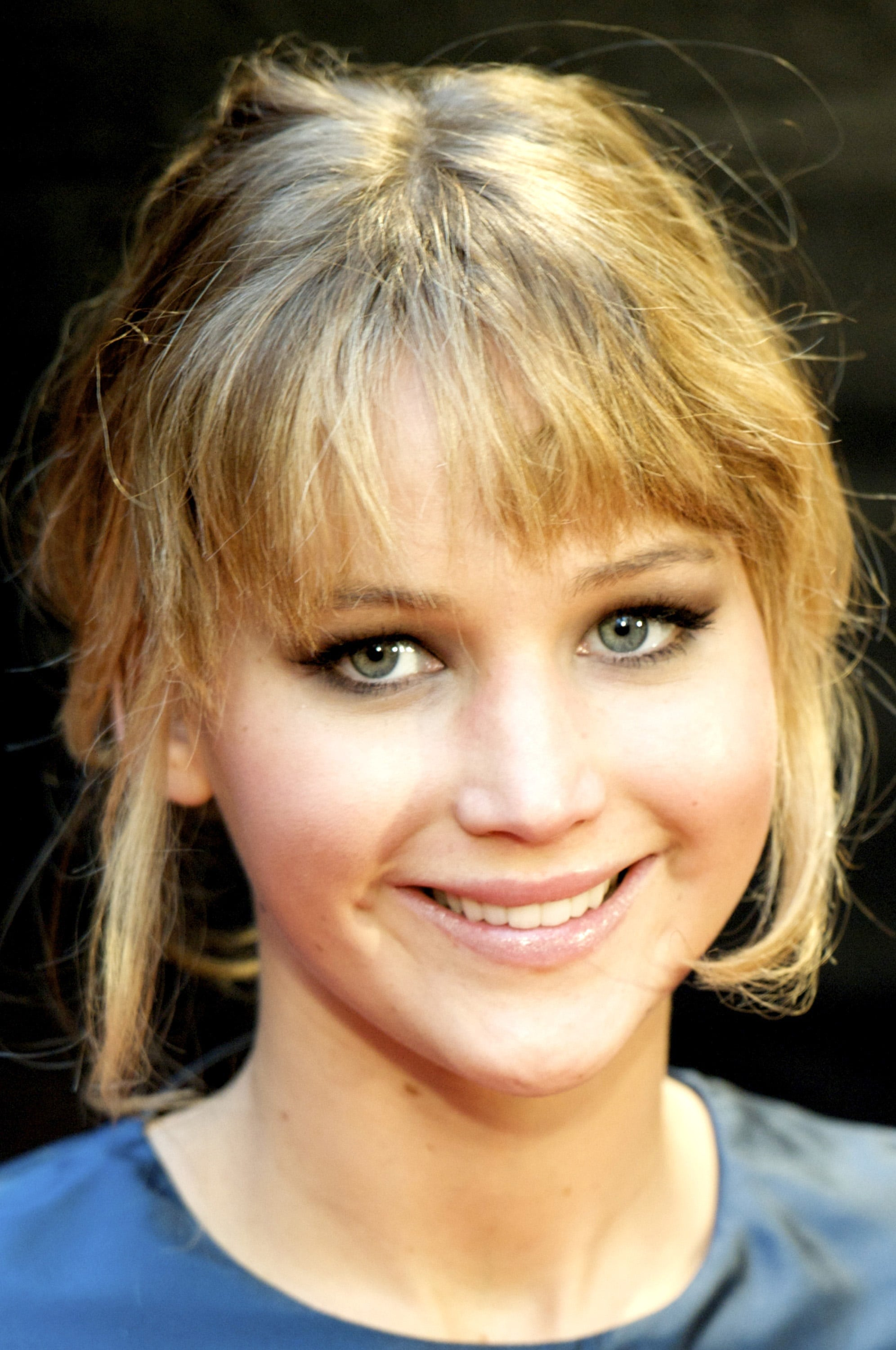 Jennifer Lawerence with bangs and a blue dress