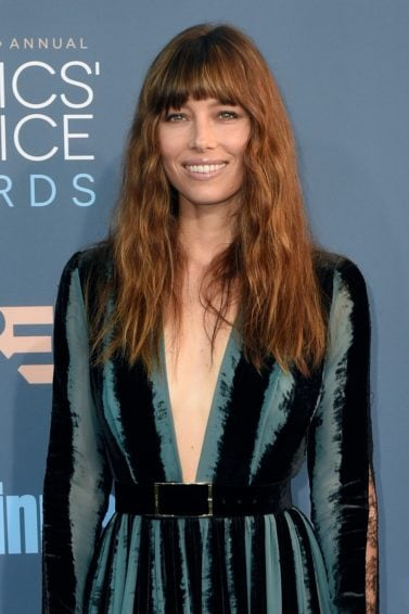 Jessica Biel at the critics choice awards with long bang hairstyle wearing a velvet long sleeve gown