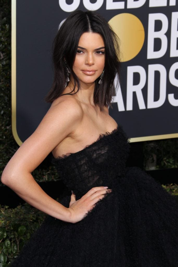 close up shot of kendall jenner with loosely waved medium bob hairstyle on the golden globes red carpet, wearing black dress