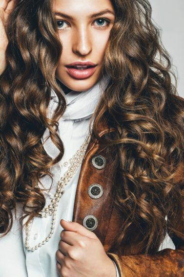 female model with layered long curly hair