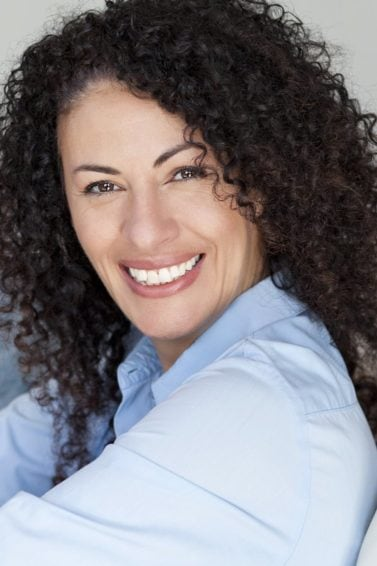 mature woman with curly brown hair