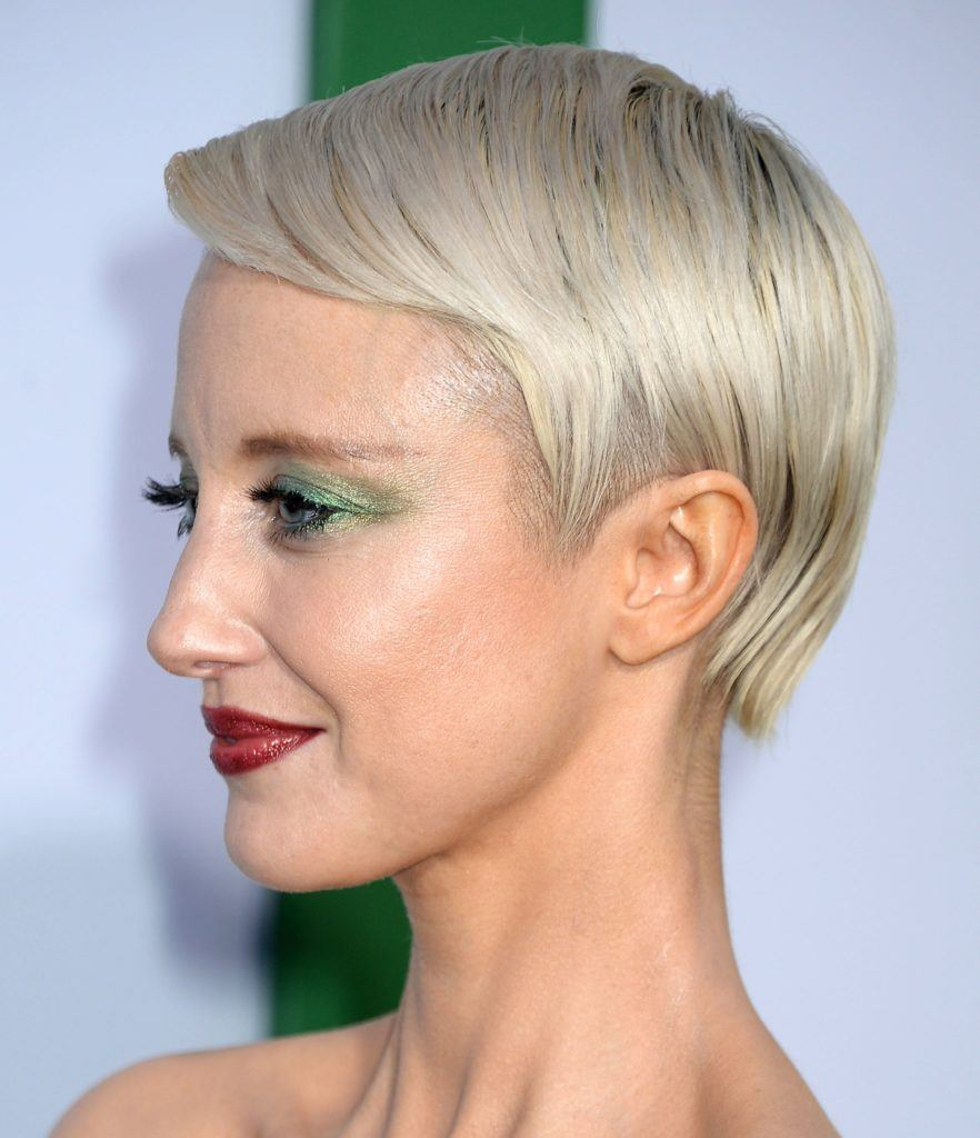 andrea riseborough with a silver pixie cut with a slight side fringe