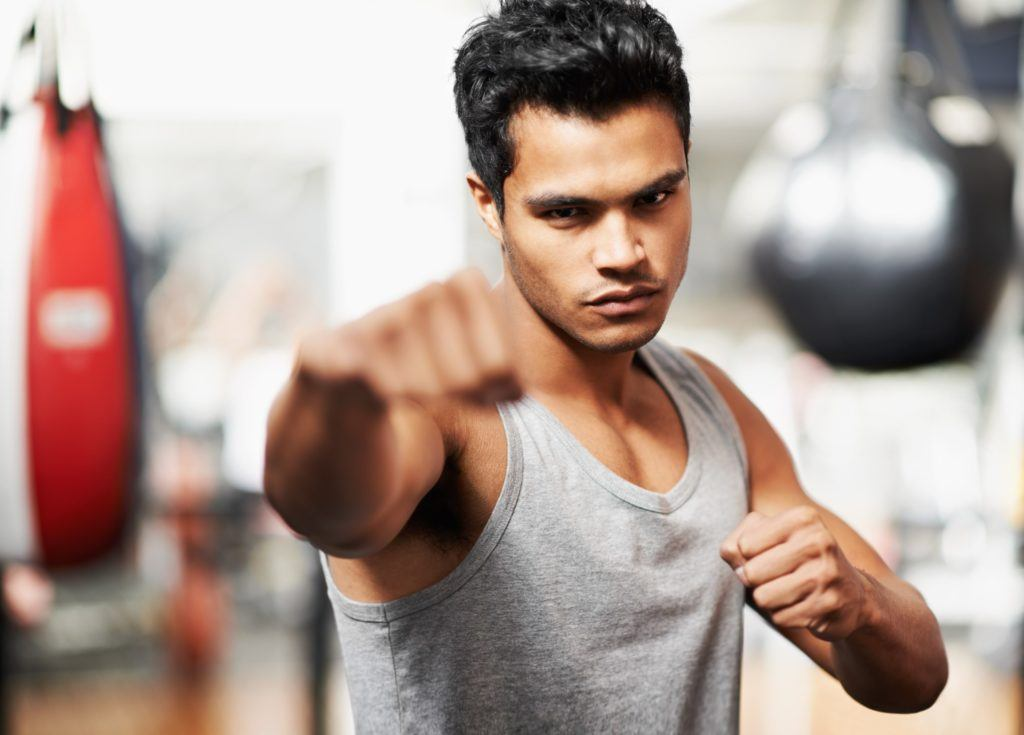 male model with quiff hairstyle in boxing pose gym hairstyles men