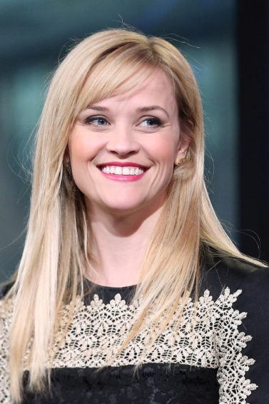 Reese Witherspoon with side swept hairstyle and long dress