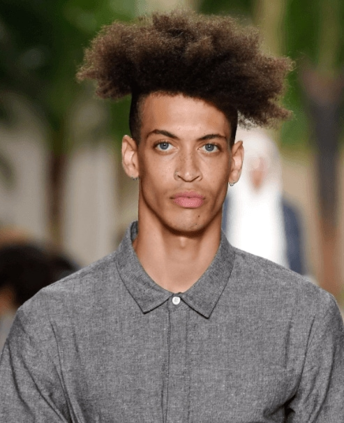 front facing image of a man with afro hair, a high fade and long top style - cool haircuts