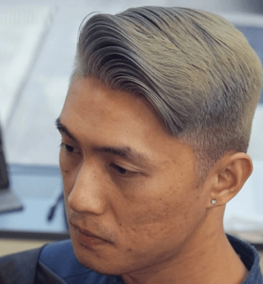 image of a man with a tapered haircut and grey colour hair - cool haircuts