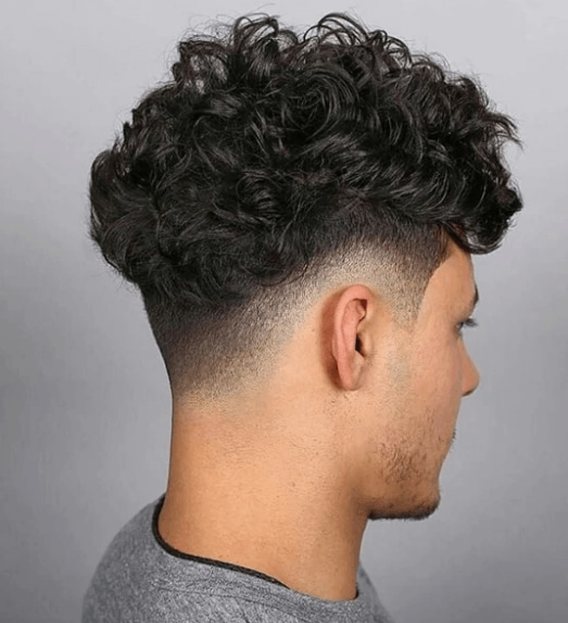 back view of a mans head with short sides and curly sides - cool hairscuts