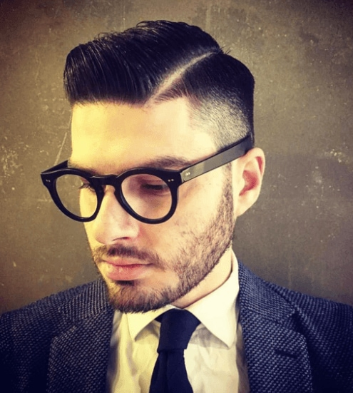 front view image of a man with dark hair, a beard and glasses - cool haircuts