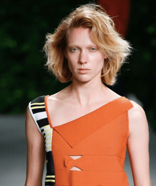 front facing image of a woman with blonde hair in a layered bob - volume hair